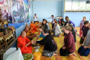 Receiving blessings from the village monks